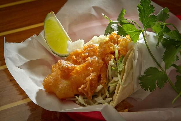 The Baja-style taco at Tacko features beer-battered fish, cilantro, cabbage and red onions. Photo: John Storey, Special To The Chronicle