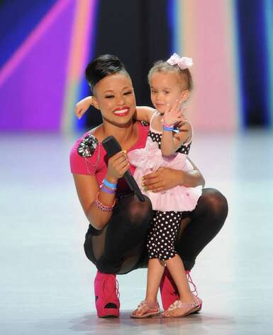 "Paige Thomas hugs her 3-year-old daughter after performing on ""X Factor."""