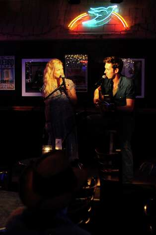"NASHVILLE - ""Nashville"" stars Connie Britton as Rayna, Hayden Panettiere as Juliette, Powers Boothe as Lamar, Charles Esten as Deacon, Eric Close as Teddy, Clare Bowen as Scarlett, Jonathan Jackson as Avery, Sam Palladio as Gunnar and Robert Wisdom as Coleman. ""Nashville"" was written by Callie Khouri who is an executive producer along with R.J. Cutler and Steve Buchanan. The pilot for ""Nashville"" was directed by R.J. Cutler. The series is produced by Lionsgate, ABC Studios and Gaylord Entertainment. (ABC/KATHERINE BOMBOY-THORNTON) CLARE BOWEN, SAM PALLADIO Photo: Katherine Bomboy-Thornton, ABC / © 2012 American Broadcasting Companies, Inc. All rights reserved."