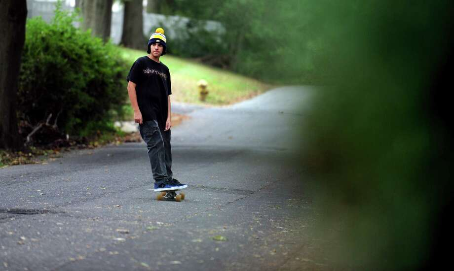 Fourteen-year-old Tyler Purcell rides his skateboard Tuesday, Oct. 9, 2012 near his home in the Black Rock section of Bridgeport. Photo: Autumn Driscoll / Connecticut Post