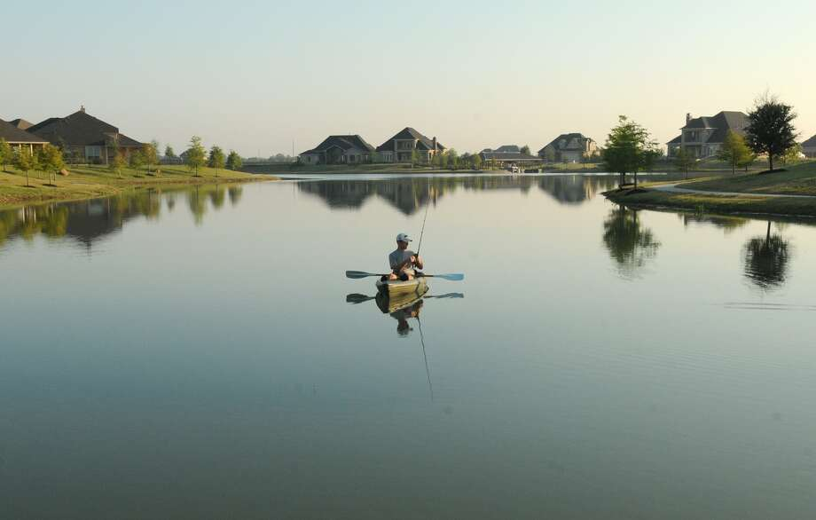 Ryan Barry fishes from his kayak on Towne Lake. Photo: Jerry Baker