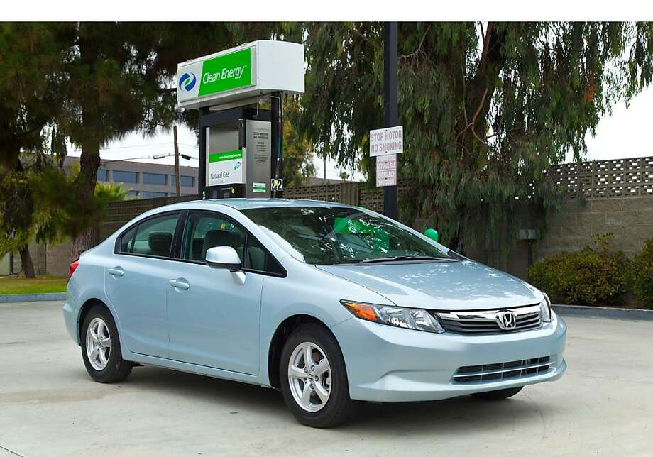As an incentive to buy Honda's compressed natural gas, owners get debit cards for Clean Energy Fuels stations. Photo: Associated Press