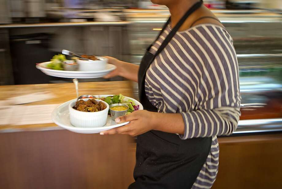 Food makes it way out of the kitchen for lunch at Moya Ethiopian Eatery & Cafe in San Francisco, Calif., is seen Thursday, July 18th, 2012. Photo: John Storey, Special To The Chronicle