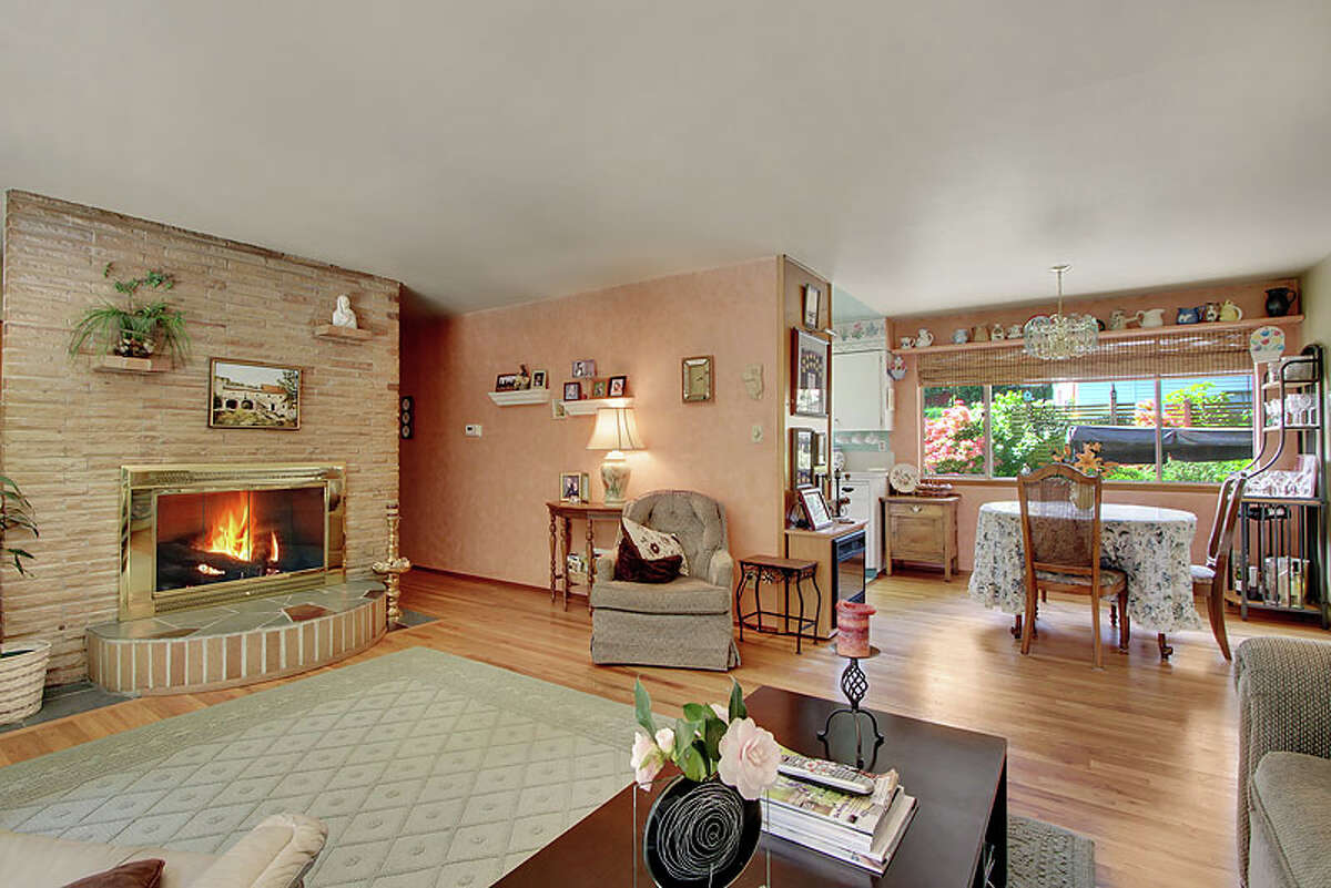 Living room of 11806 33rd Ave. N.E. The 1,680-square-foot house, built in 1957, has four bedrooms, 1.5 bathrooms, a rec room with a fireplace, large windows and a patio on a 7,651-square-foot lot. It's listed for $355,000.