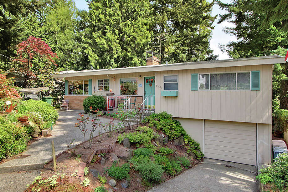 Meadowbrook provides more of a suburban feel and lower prices than many neighborhoods further south, but is still convenient to the rest of Northeast Seattle and downtown. Here are some homes listed there for less than $400,000, starting with 11806 33rd Ave. N.E. The 1,680-square-foot house, built in 1957, has four bedrooms, 1.5 bathrooms, a big brick fireplace in the living room, a rec room with a fireplace, large windows and a patio on a 7,651-square-foot lot. It's listed for $355,000. Photo: Courtesy Gary O'Leyar/Prudential SignatureProperties, Vicaso