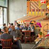 People enjoy lunch at Moya Ethiopian Eatery & Cafe in San Francisco.