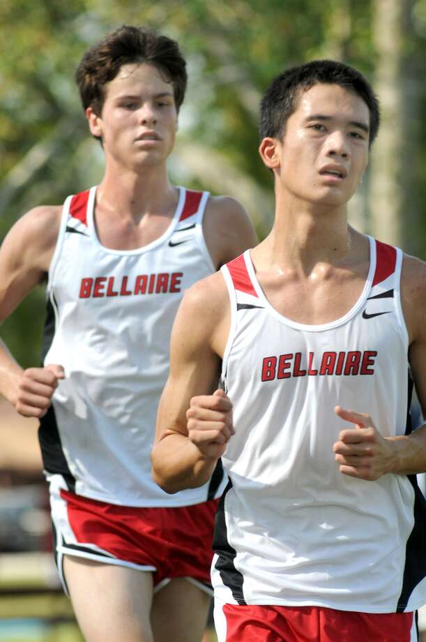 Bellaire's Connor Carter, front, a junior, and teammate Karl Mall, a sophomore, compete in the Varsity Boys race at the Bellaire Invitational. Freelance photo by Jerry Baker Photo: Jerry Baker