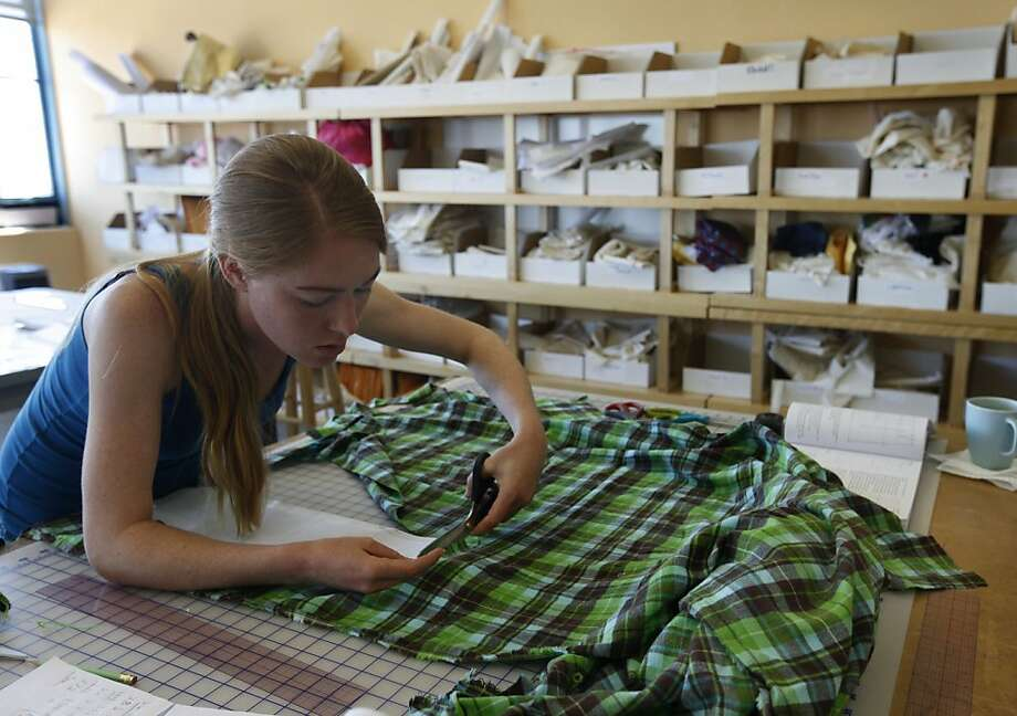 "Amanda Fulford cuts fabric in a pattern-making class at Apparel Arts in San Francisco: ""We really push the technical,"" says founder Suzy Furrer. Photo: Paul Chinn, The Chronicle"