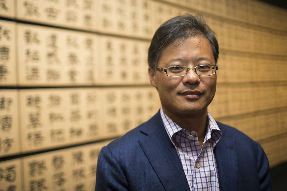 "Yahoo! Inc. founder and art collector Jerry Yang stands for a portrait in front of clerical script ""Thousand-Character Classic"" by Wen Peng during a tour of the exhibit ""Out of Character: Decoding Chinese Calligraphy"" at the Asian Art Museum exhibitin San Francisco, Calif. on Wednesday, Oct. 3, 2012. Photo: Stephen Lam, Special To The Chronicle"