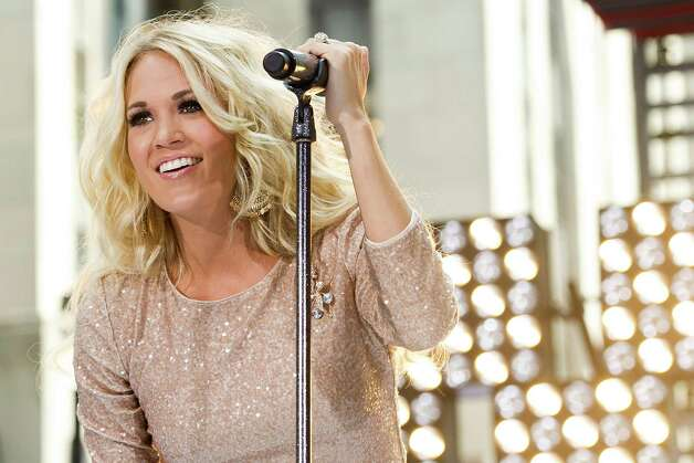 FILE - In this Aug. 15, 2012 file photo, Carrie Underwood performs on NBC's