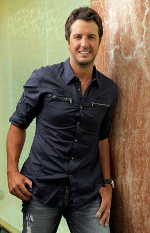 "FILE - In this July 12, 2011 file photo, country music artist Luke Bryan poses for a photo in Nashville, Tenn. Bryan ""   Bryan and The Band Perry's Kimberly Perry are ready to see a week's worth of hard work pay off when ""CMA Music Festival: Country's Night to Rock"" airs Monday on ABC.  They are co-hosts for the three-hour TV special, which highlights the biggest performances and behind-the-scenes moments of CMA Fest. It was filmed June 7-10 in Nashville, Tenn. (AP Photo/Donn Jones) Photo: Donn Jones, FRE / FR50384 AP"