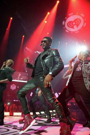 This Sept. 21, 2012 photo released by Clear Channel shows Usher performing at the 2012 iHeartRadio Music Festival at the MGM Grand Garden Arena in Las Vegas, Nev. (AP Photo/Clear Channel, Brian Friedman) Photo: Brian Friedman, HOEP / Clear Channel