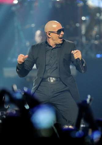 Pitbull performs at iHeart Radio Music Festival on Saturday, Sept., 22, 2012 at the MGM Grand Arena in Las Vegas. (Photo by Eric Reed/Invision/AP) Photo: Eric Reed, INVL / Invision