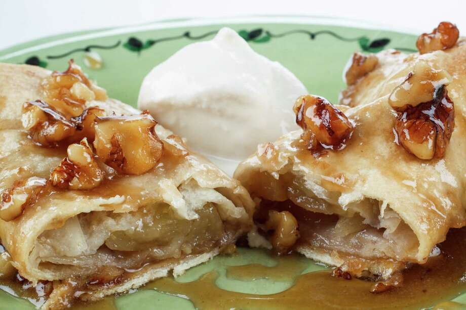 These Apple Enchiladas use flour tortillas and apple pie filling to create a delicious seasonal dessert. Photo: Michael Paulsen / © 2012 Houston Chronicle