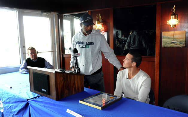 Bluefish Manager Willie Upshaw praises former player Adam Greenberg, during a press conference at the Ballpark at Harbor Yard in Bridgeport, Conn. on Tuesday October 9, 2012. In Greenberg's very first at bat as a major league player in 2005, he was hit in the head by the first pitch by a Marlins pitcher. He has been on the Bluefish team since 2008, but last week he was able to play a game for the Florida Marlins. Photo: Christian Abraham / Connecticut Post
