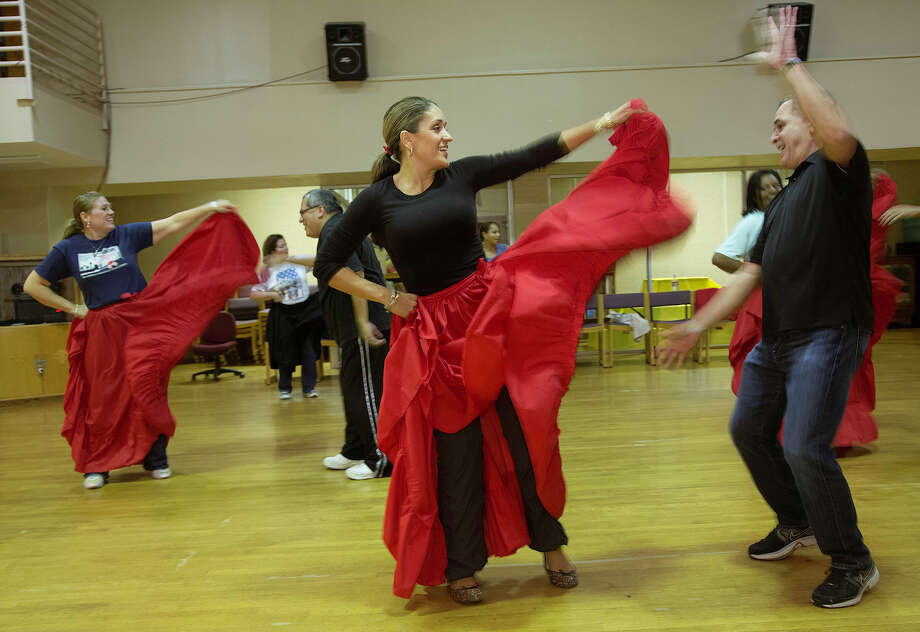 Jennifer Garza, from the left, Martin Perez, Maria Custodio and Francisco Vias, with Ballet Folklorico Boriken, work through their program of Puerto Rican dances for a Founders Day performance at the OLLU International Folk Cultural Center, Monday, October 8, 2012 in San Antonio. Photo: J. MICHAEL SHORT, For The Express-News / San Antonio Express-News
