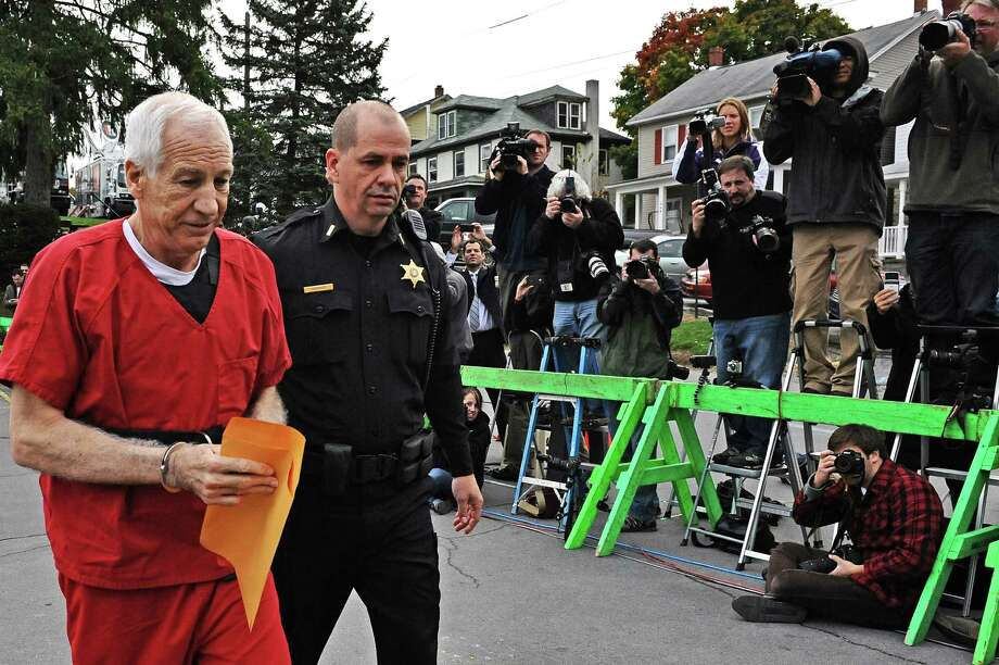 BELLEFONTE, PA - OCTOBER 09: Former Penn State assistant football coach Jerry Sandusky (L) walks into the Centre County Courthouse before being sentenced in his child sex abuse case on October 9, 2012 in Bellefonte, Pennsylvania. Sandusky faces more than 350 years in prison for his conviction in June on 45 counts of child sexual abuse, including while he was the defensive coordinator for the Penn State college football team. Photo: Patrick Smith, Getty Images / 2012 Getty Images