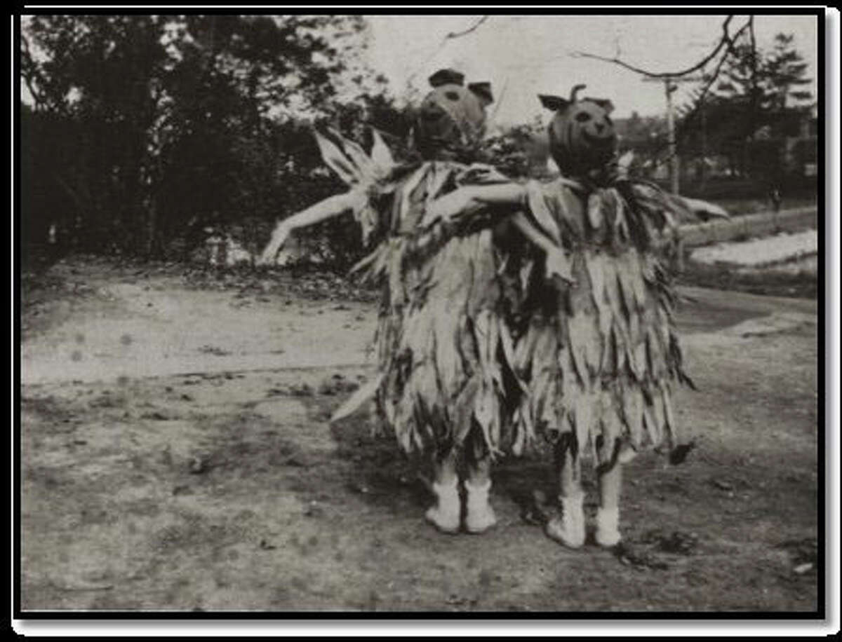 Constant and Clarissa MacRae model their scarecrow costumes for a Halloween celebration held sometime during the early 1900s.