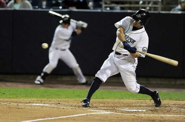 Adam Greenberg swings at a ball during Friday's Bluefish game at the Ballpark at Harbor Yard in Bridgeport on April 29, 2011. Photo: Lindsay Niegelberg, ST / Connecticut Post