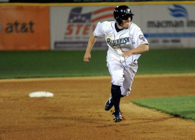 Adam Greenberg rounds the bases during Friday's Bluefish game at the Ballpark at Harbor Yard in Bridgeport on April 29, 2011. Photo: Lindsay Niegelberg, ST / Connecticut Post