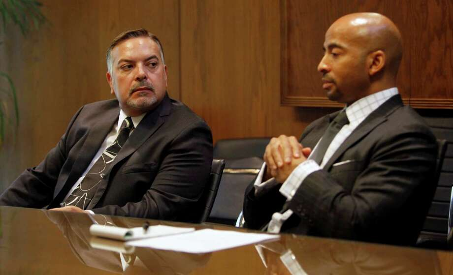 Henry Muñoz (left) listens on Oct. 9, 2012, as VIA President and CEO Keith Parker talks about his resignation from VIA to accept the general manager job at Atlanta's public transit agency. Photo: William Luther, San Antonio Express-News / © 2012 San Antonio Express-News