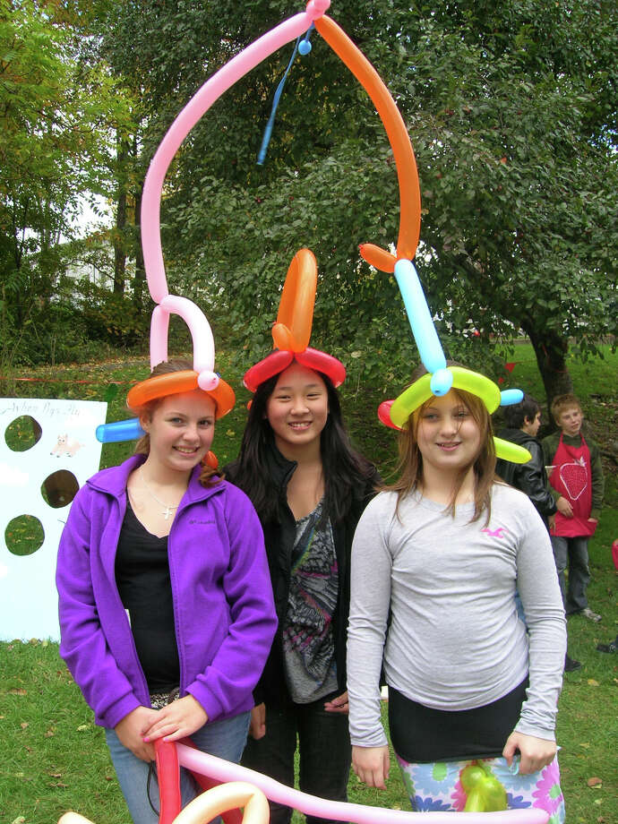 Pete Lane, a clown who makes silly balloon hats, concocted these colorful creations for three girls at Brookfieldís annual Yankee Fair and Barn Sale. This year's fair will be Saturday, Oct. 13. (If you already have a balloon hat, try a balloon animal!) Photo: Contributed Photo
