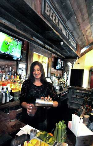 Kristen Harrigan tends bar at Little Pub in Ridgefield Saturday, Sept. 22, 2012. Photo: Michael Duffy / The News-Times