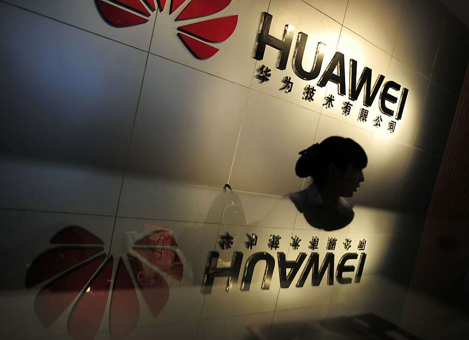 In this Monday, Oct. 8, 2012 photo, an employee works at a reception counter of a R&D center of Huawei Technologies Inc. in Wuhan, in central China's Hubei province. Eager to expand in the United States, China's biggest technology companies face American anxiety about security and rising Chinese competition.(AP Photo)  CHINA OUT Photo: Shepherd Zhou, Associated Press