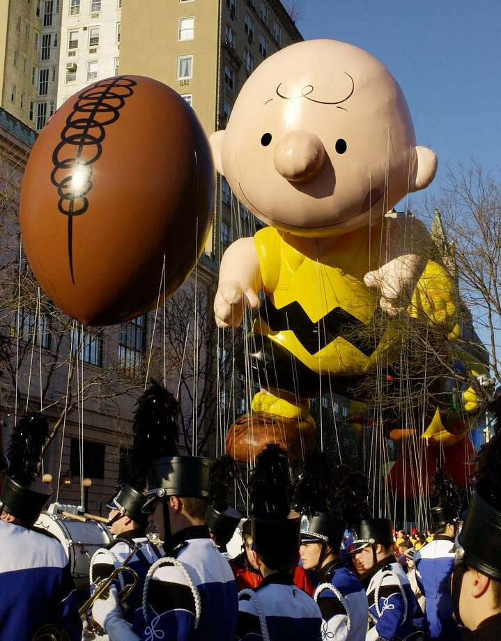 "Charlie Brown and ""elusive football"" made their balloon debut at the Macy's Thanksgiving Day Parade in 2002.  Photo: STAN HONDA / AFP"