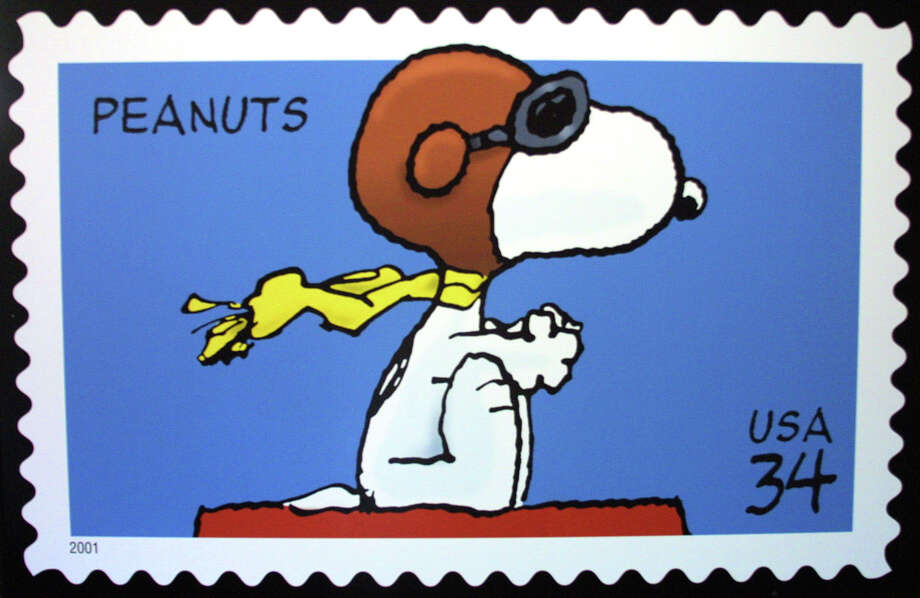 "Long after the comic strips stopped, the legacy of ""Peanuts"" lives on. The U.S. Postal Service released this Snoopy stamp in 2001.  Photo: SUSAN RAGAN / U.S. POSTAL SERVICE"