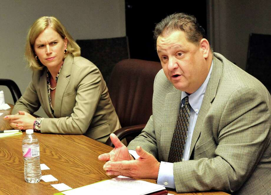Lisa Romano, the Democratic candidate for state representative in the 106th District, left, and Mitch Bolinsky, the Republican candidate for state representative in the 106th District, talk with The News-Times editorial board Friday, Oct. 5, 2012. Photo: Michael Duffy / The News-Times