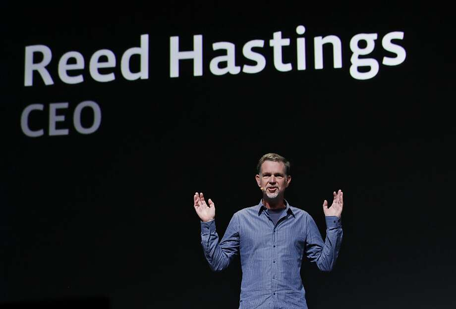 FILE - In this Thursday, Sept. 22, 2011, file photo, Netflix CEO Reed Hastings gestures during the Facebook f/8 conference in San Francisco. Netflix CEO Reed Hastings announced Tuesday, Oct. 9, 2012, that he is stepping down from Microsoft's board of directors next month. Hastings says he will end his five-and-half-year stint on the software maker's board to concentrate on running Netflix Inc. at a time the video subscription service is facing an assortment of challenges threatening its future growth. (AP Photo/Paul Sakuma) Photo: Paul Sakuma, Associated Press