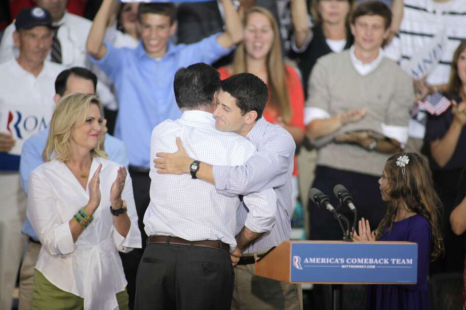 WAUKESHA, WI - AUGUST 12: Republican presidential candidate and former Massachusetts Gov. Mitt Romney and vice presidential candidate and Wisconsin native Rep. Paul Ryan (R-WI) (L) hug after speaking at a campaign event at the Waukesha Expo Center on August 12, 2012 in Waukesha, Wisconsin. Romney continues his four day bus tour a day after announcing his running mate, Rep. Paul Ryan. (Photo by Darren Hauck/Getty Images) (Darren Hauck / Getty Images)