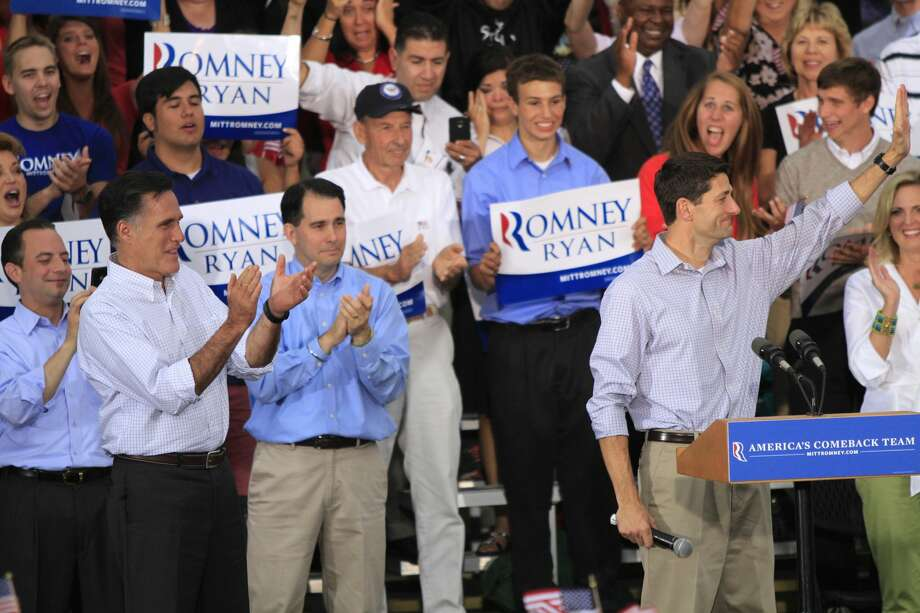 WAUKESHA, WI - AUGUST 12: Republican presidential candidate and former Massachusetts Gov. Mitt Romney and vice presidential candidate and Wisconsin native Rep. Paul Ryan (R-WI) (R) speak to supporters during a campaign event at the Waukesha Expo Center on August 12, 2012 in Waukesha, Wisconsin. Romney continues his four day bus tour a day after announcing his running mate, Rep. Paul Ryan. (Photo by Darren Hauck/Getty Images) (Darren Hauck / Getty Images)