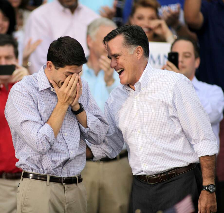 WAUKESHA, WI - AUGUST 12: Republican vice presidential candidate and Wisconsin native Rep. Paul Ryan (R-WI) (L) wipes away tears as he and presidential candidate and former Massachusetts Gov. Mitt Romney greet supporters during a campaign event at the Waukesha Expo Center on August 12, 2012 in Waukesha, Wisconsin. Romney continues his four day bus tour a day after announcing his running mate, Rep. Paul Ryan. (Photo by Darren Hauck/Getty Images) (Darren Hauck / Getty Images)