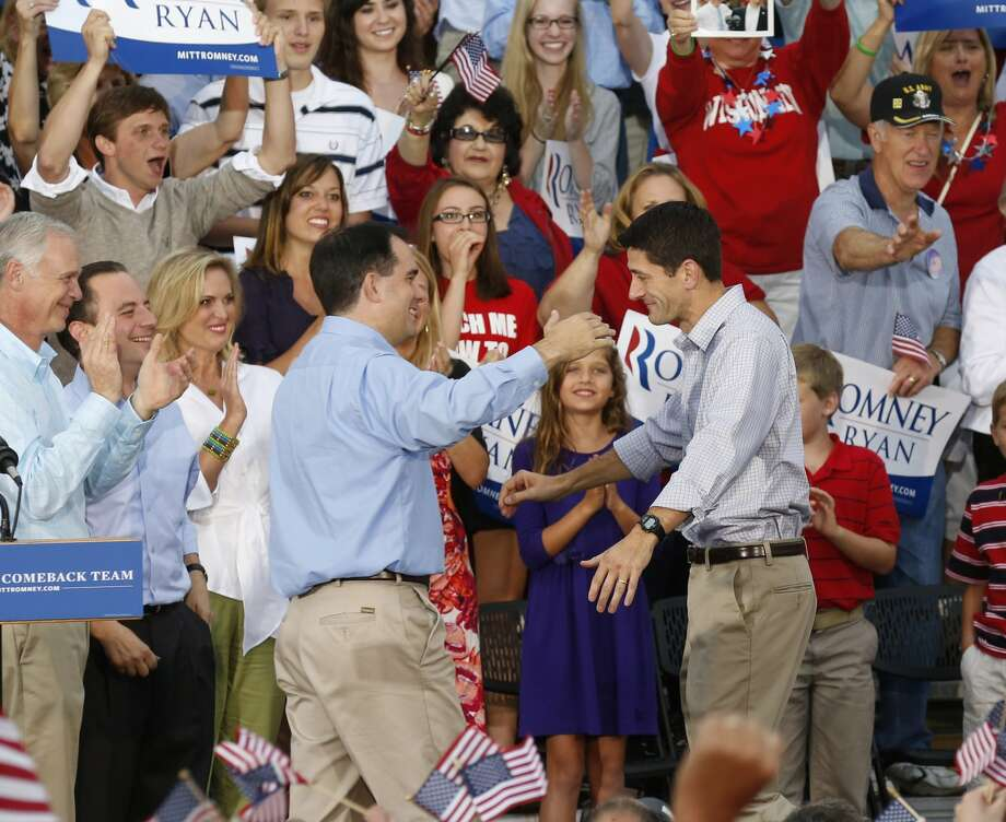 Vice presidential running mate Rep. Paul Ryan, R-Wis, right,  greets Wisconsin Gov. Scott Walker at his  welcome home rally Sunday, Aug., 12, 2012 in Waukesha, Wis. (AP Photo/Jeffrey Phelps) (JEFFREY PHELPS / Associated Press)