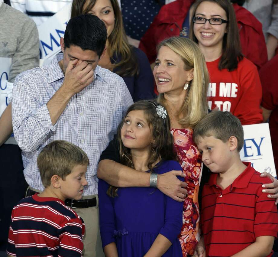 Republican vice presidential running mate Rep. Paul Ryan, R-Wis., left, fights back tears with his family, wife Janna, daughter Liza with sons Charles and Sam, at his side during a welcome home rally, Sunday, Aug. 12, 2012 in Waukesha, Wis. (AP Photo/Jeffrey Phelps) (Jeffrey Phelps / Associated Press)
