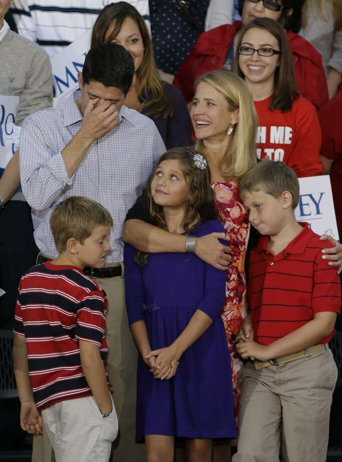 Vice presidential running mate Rep. Paul Ryan, R-Wis,left, fights back tears with his family at his side at a welcome home rally Sunday, August, 12, 2012 in Waukesha, Wis. (AP Photo/Jeffrey Phelps) (JEFFREY PHELPS / Associated Press)