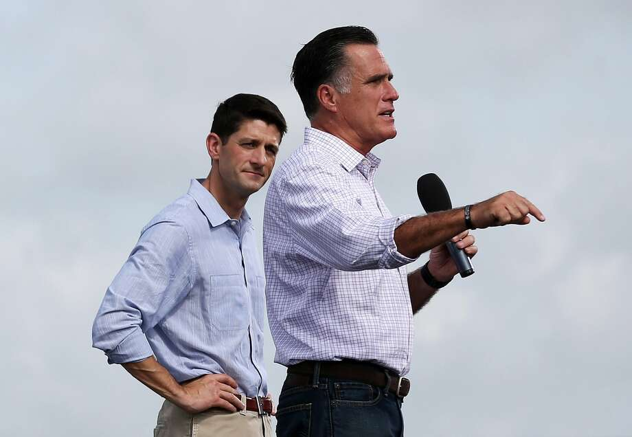 LAKELAND, FL - AUGUST 31:  Republican vice presidential candidate, U.S. Rep. Paul Ryan (R-WI) (L) looks on as Republican presidential candidate, former Massachusetts Gov. Mitt Romney speaks during an RNC Farewell Victory rally on August 31, 2012 in Lakeland, Florida. A day after former Massachusetts Gov. Mitt Romney was nominated as the Republican presidential candidate at the RNC, he and his running mate Rep. Paul Ryan (R-WI) returned to the campaign trail.  (Photo by Justin Sullivan/Getty Images) (Getty Images)