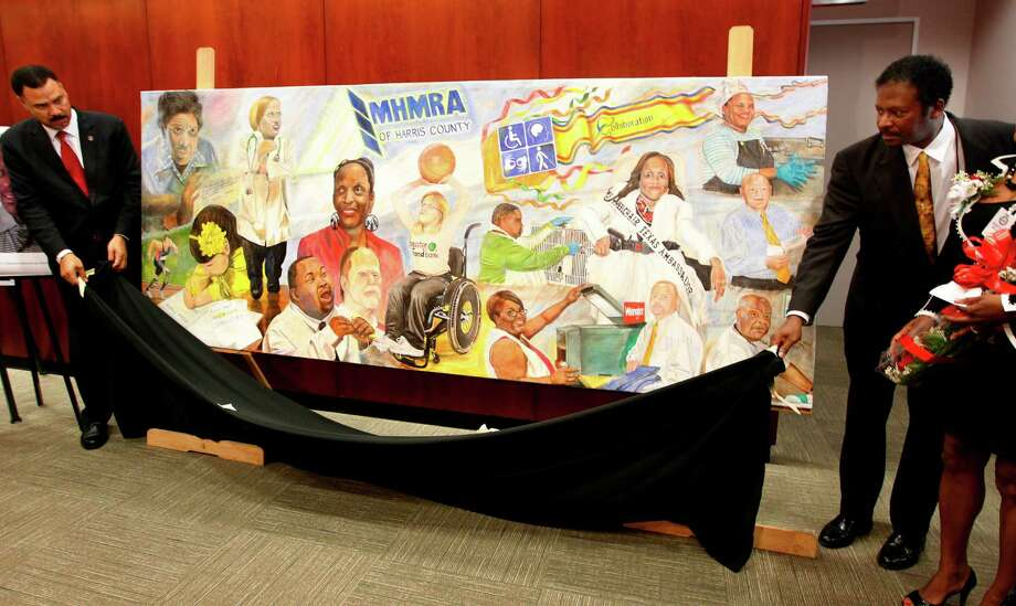 "Houston City Council member C.O. ""Brad"" Bradford and artist Doyle Burley unveil the mural ""Out of the Shades"" at the City Hall Annex on Tuesday, Oct. 9, 2012, in Houston.  The mural depicts the many faces of people with disabilities. The mural will travel around the city and will be displayed at various events. Photo: Mayra Beltran, Houston Chronicle / © 2012 Houston Chronicle"