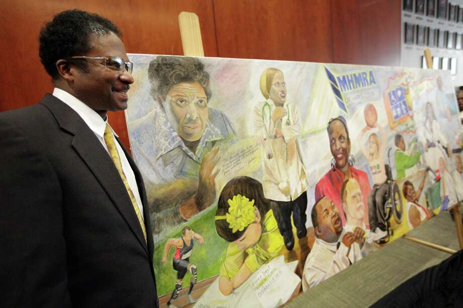 "Artist Doyle Burley smiles while being photographed with his mural titled ""Out of the Shades"" on display at City Hall Annex on Tuesday, Oct. 9, 2012, in Houston. Photo: Mayra Beltran, Houston Chronicle / © 2012 Houston Chronicle"