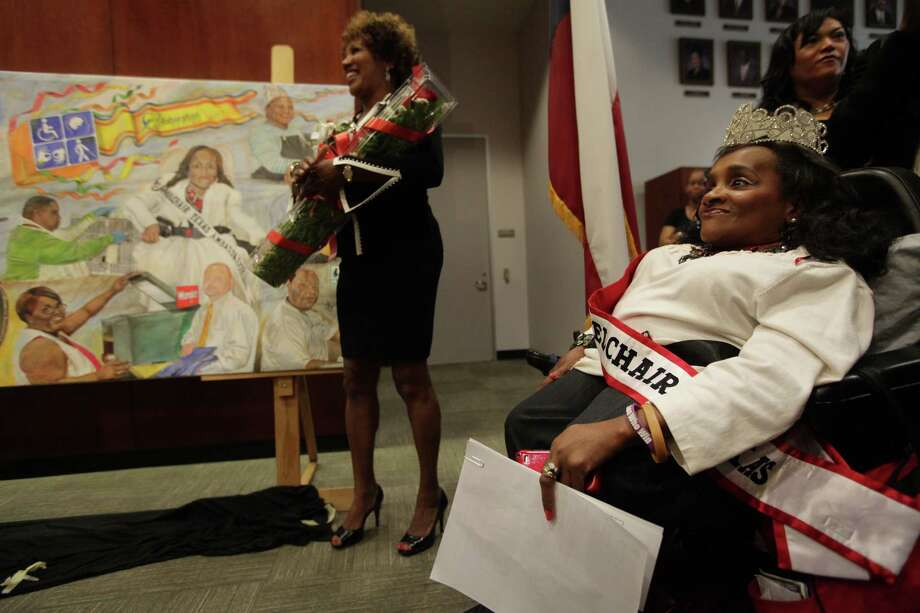 Tina X. Williams, 45, Ms. Wheelchair of Texas, smiles as she sees all the activity around the mural after it's unveiling at City Hall Annex on Tuesday, Oct. 9, 2012, in Houston. Photo: Mayra Beltran, Houston Chronicle / © 2012 Houston Chronicle