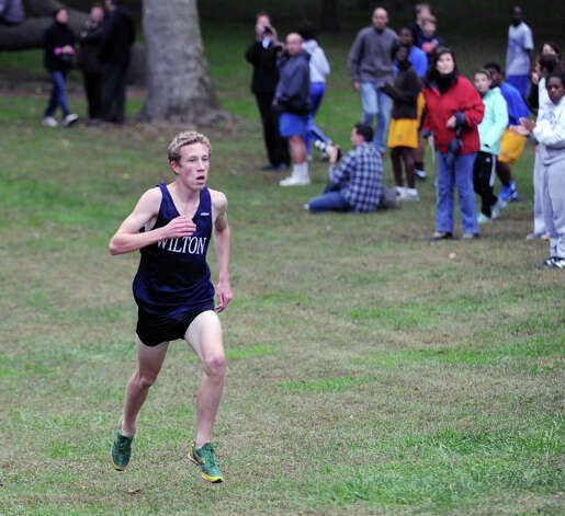 Spencer Brown of Wilton High School during the boys high school cross country meet at Greenwich Point, Tuesday afternoon, Oct. 9, 2012. Brown won the race. Photo: Bob Luckey / Greenwich Time