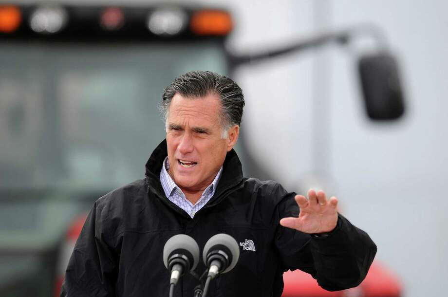 U.S. Republican presidential candidate, former Massachusetts Gov. Mitt Romney speaks at a rally on a farm on Oct. 9, 2012 near Van Meter, Iowa. Photo: Steve Pope, Getty Images / 2012 Getty Images