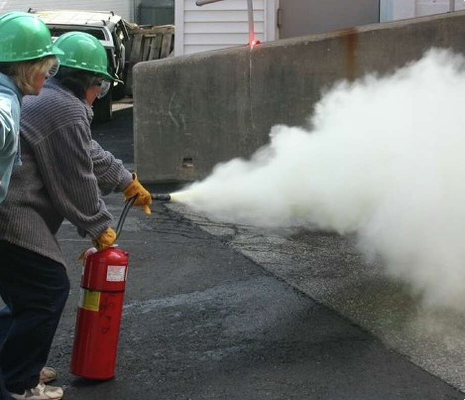 How to handle a fire extinguisher is one of the tools that participants in the CERT training course will learn. Photo: Contributed