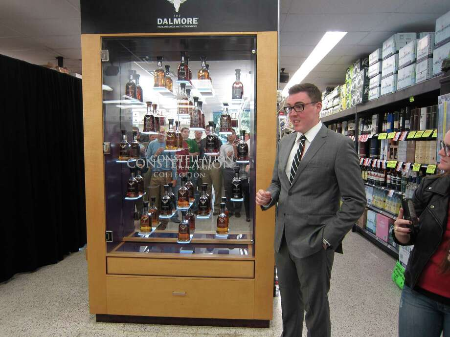 Chris Watt, global head of brand of Dalmore, unveils the Scottish whiskey distiller's $250,000, 21-bottle Constellation Collection at Spec's Warehouse. Photo: Syd Kearney