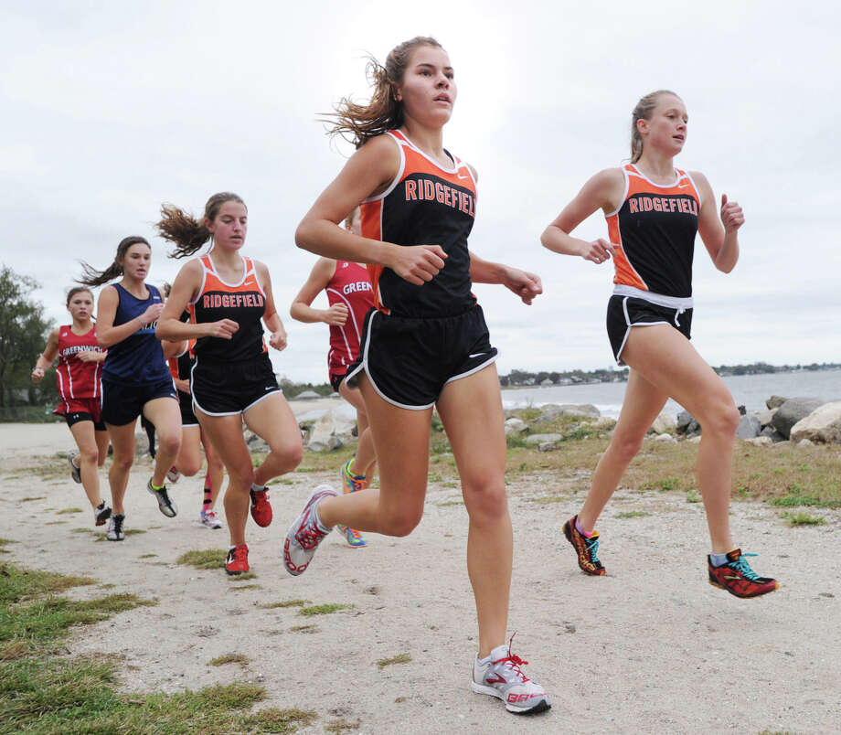 At center, Laura Hergenrother of Ridgefield High School runs during the girls high school cross country meet at Greenwich Point, Tuesday afternoon, Oct. 9, 2012. Hergenrother came in first in the race.  Teammate Caroline Carr, at right, finished second. At left, also of Ridgefield HIgh School, is Sarah Guillaume who finished third. Photo: Bob Luckey / Greenwich Time