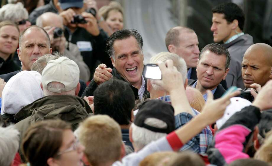 Republican presidential candidate, former Massachusetts Gov. Mitt Romney greets supporters after speaking at a campaign stop at the Koch Family Farm, Tuesday, Oct. 9, 2012, in Van Meter, Iowa. (AP Photo/Charlie Neibergall) Photo: Charlie Neibergall / AP