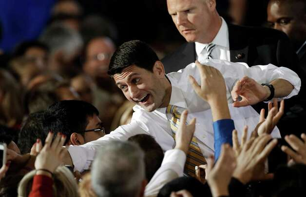 Republican vice presidential candidate, Rep. Paul Ryan, R-Wis., shakes hands with the crowd at a rally at Oakland University in Rochester, Mich., Monday, Oct. 8, 2012. (AP Photo/Paul Sancya) Photo: AP, STF / AP
