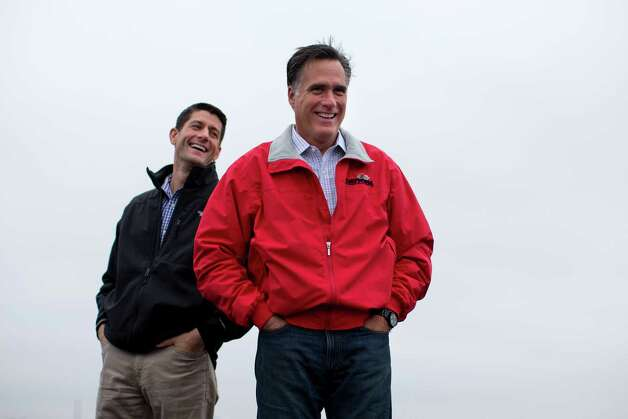 Republican presidential candidate, former Massachusetts Gov. Mitt Romney stands with his vice presidential running mate Rep. Paul Ryan, R-Wis., during a campaign rally on Tuesday, Sept. 25, 2012 in Vandalia, Ohio. (AP Photo/ Evan Vucci) Photo: AP, STF / AP